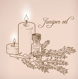 Juniper essential oil and candles Stock Photo