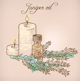 Juniper essential oil and candles Royalty Free Stock Photos