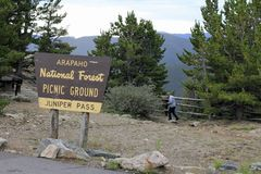 Juniper Pass Picnic Grounds Sign. Idaho Springs, CO, USA: At 11,000 feet this scenic picnic area overlooks evergreen forest. Juniper Pass Picnic Grounds sign in Royalty Free Stock Images
