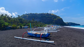 Junk on the beach of black sand Royalty Free Stock Images