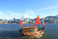 Junk boat along Victoria Harbour in Hong Kong Royalty Free Stock Images