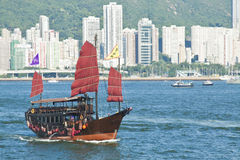 Junk boat in harbour of Hong Kong Stock Photo