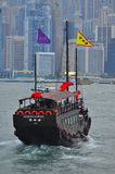 Junk boat in Hong Kong. A traditional junk boat or sampan in Hong Kong used to transport tourist at Victoria Harbour City in Hong Kong. This mode of stock images