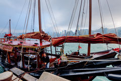 Junk Boat in Hong Kong. Hong Kong, China - January 31, 2016: A Traditional Chinese Junk boat is about to dock at Victoria Harbor in Hong Kong Stock Image