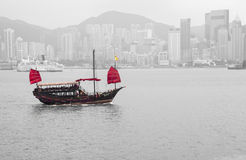 The junk boat. HONG KONG - FEBRUARY 25: The junk boat  in Victoria harbor on February 25, 2013 in Hong Kong. A red chinese traditional junk boat, Aqua Luna, is Stock Photo