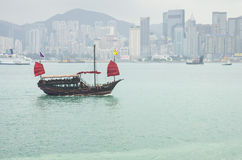 The junk boat. HONG KONG - FEBRUARY 25: The junk boat  in Victoria harbor on February 25, 2013 in Hong Kong. A red chinese traditional junk boat, Aqua Luna, is Stock Photography