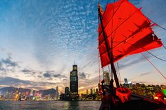 Junk boat in Hong Kong. Junk boat with red sail in Hong Kong royalty free stock photos
