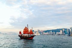 Junk boat in Hong Kong. Junk boat with red sail in Hong Kong royalty free stock images