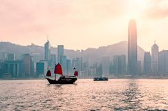 Junk boat in Hong Kong at Victoria harbour. Junk boat in Hong Kong at Victoria harbour in the evening : The famous place in Hong Kong , China stock photo