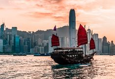 Junk Boat in Hong Kong. View of Hong Kong at Vicotria harbor with junk boat in the morning stock photography