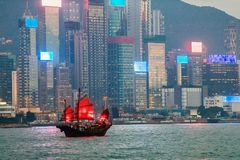 Junk boat in Hong Kong. Junk boat with red sail in Hong Kong stock images