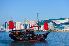 Junk boat sailing in Victoria habour, Hong Kong. Red sail Chinese wooden junk boat sailing in Victoria habour, Hong Kong Royalty Free Stock Photo