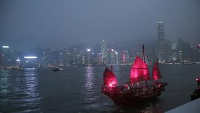 Junk Boat Sailing in Victoria Harbour stock video