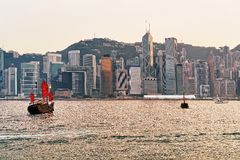 Junk boat at the Victoria Harbor in Hong Kong at sundown Royalty Free Stock Images