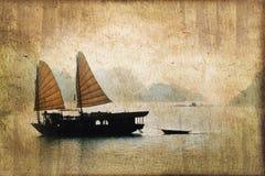 Junk boats in Halong Bay, Vietnam, vintage sepia process Royalty Free Stock Photography