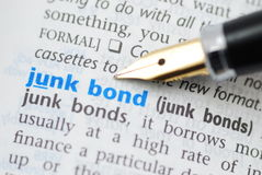 Junk bond - Dictionary Series. Fountain pen pointing Junk bond word Stock Image