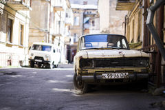 Junk car. Odessa, Ukraine - April 16, 2016. Junk car and a van blurred on the background Royalty Free Stock Image