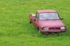 Junk car abandoned on a meadow. Old junk car abandoned on a meadow stock images