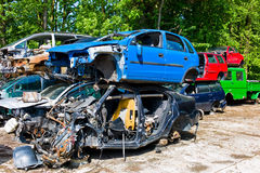 Junk cars in a junkyard. Many junk cars in a junkyard waiting for their transport in dei crusher royalty free stock photography