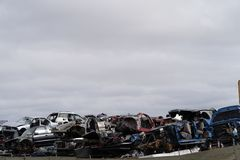 Junk Cars Stacked in Scrap Yard for recycling royalty free stock images