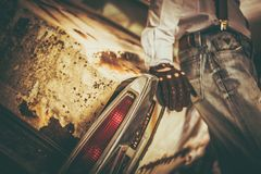 Junk Classic Car Sentiments. The Men and His Aged Classic Car. Closeup Photo Stock Images