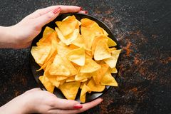 Junk fast food eating chips woman hands bowl royalty free stock photography