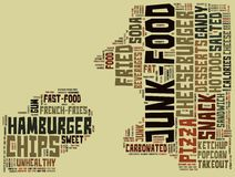Junk food. A man eating junk food, made with words. There is a list of the most common foods that usually are considered rather unhealthy Stock Photo