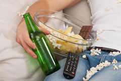 Junk food, bottle and remote Royalty Free Stock Photos