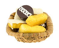 Junk food cakes and donuts in basket. An old wicker basket filled with junk food including cream filled cakes, chocolate iced cakes and iced covered cakes on a Stock Photos