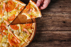 Junk food, calories. Pizza cut on slices, flat lay Royalty Free Stock Images