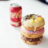 Junk food concept with Coca Cola drink and donut Royalty Free Stock Photo