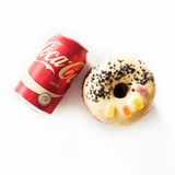 Junk food concept with Coca Cola drink and donut Royalty Free Stock Image