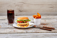 Junk food with cutlery. Stock Photo