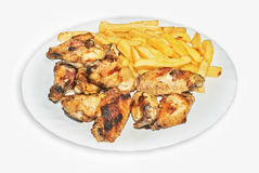 Junk food. Grilled chicken wings with fries Stock Photography