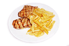 Junk food. Grilled steak with fries on isolated background Royalty Free Stock Image