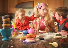 Junk Food Mother Acting Like Children Royalty Free Stock Image