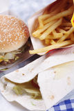 Junk food on table Royalty Free Stock Images