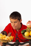 Junk food temptation. Teen finding it hard to resist the temptation of junk food royalty free stock photo