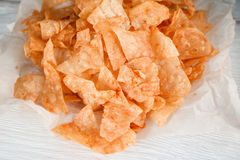Junk food, unhealthy eating. Potato chips, closeup Stock Photo