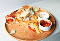 Junk food is wasted or spoiled food and other refuse, in wood di. Sh from a kitchen Stock Image