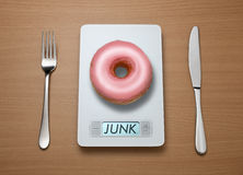 Junk Food Weight Scale Royalty Free Stock Photography