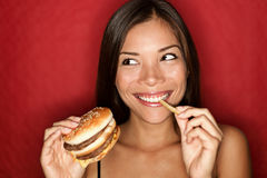 Junk food woman eating burger royalty free stock photo