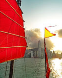 Junk in front of the skyline of Hong Kong Royalty Free Stock Image