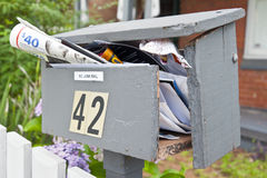Junk mail. Overflowing mailbox with junk mail. Copyspace stock photography