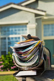 Junk mail. Mail box full of junk mails royalty free stock image