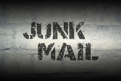 Junk mail GR. Junk mail stencil print on the grunge white brick wall Royalty Free Stock Image