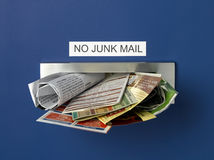 Junk Mail. Letterbox overflowing with junk mail Royalty Free Stock Photography