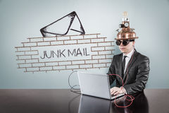 Junk mail procection concept with vintage businessman and laptop Royalty Free Stock Photos