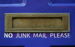 Junk mail slot. Mail slot on a house door with No Junk Mail Please text Stock Photo