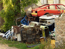 Junk yard. Wrecked cars in a scrap yard Stock Image